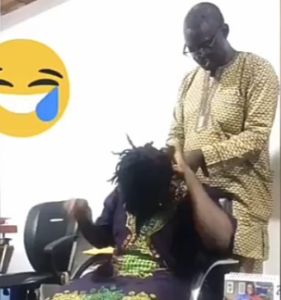 Cute video of a man unraveling his better half's locs while engaging her with Daddy Showkey's melodies