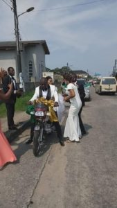Recently marry couple ride bike home after their wedding in Rivers state
